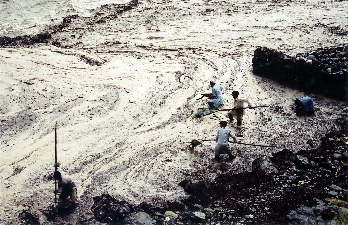 Anthony Ellis Photography: Zindabad - Fishing for Wood in the Flood