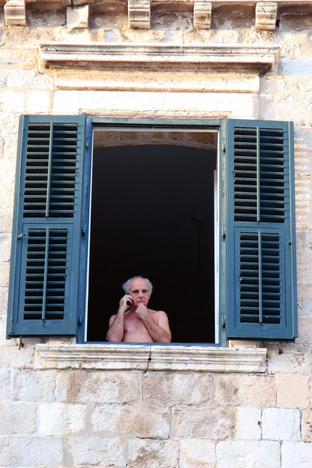 Anthony Ellis Photography: Pine Needles and Broken Tiles - Old Man in Shuttered Window on Mobile Phone